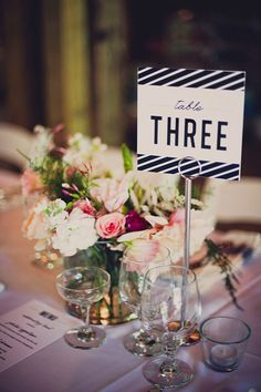 paper goods table number // photo by Khaki Bedford // http://ruffledblog.com/diy-mount-guilan-wedding
