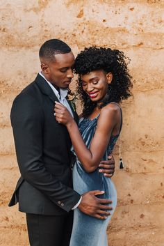 Black couple in this Black wedding inspiration. very moody with a dash of drama for a bold and unique bride, looking for something striking as the backdrop. The venue used local sand that was compacted to create the walls with their earth tones. #blackweddingideas #weddingthemes