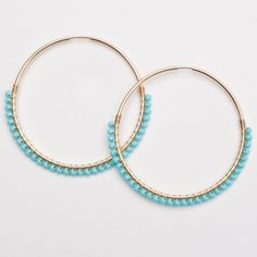 "Viv & Ingrid 1.75"" Gold & Sleeping Beauty Turquoise Skinny Wrap Hoops: A skinnier version of our Signature Wrap Hoop, these sleek hoops will become another go-to whether you're heading to the office or vacationing on the beach!"
