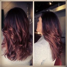 black hair fades into redish-auburn ombre... love! this would fit me without looking harsh on my dyed black hair!