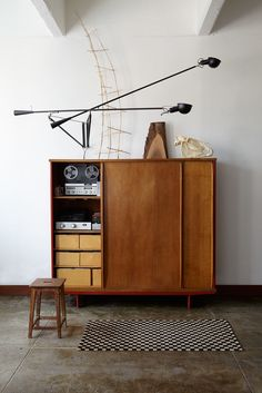 Anita Calero Calero turned a Prouvé wardrobe into a stereo cabinet and outfitted it with drawers for CD's. A typical Calero touch is t...