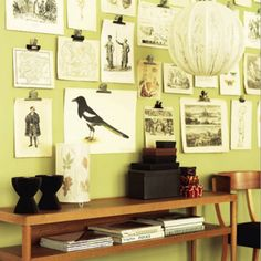 Love the simple look of industrial clips hung on tiny nails to decorate an entire wall with black & white art.