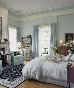 gorgeous interior, decor, front bedroom, curtains, crown mold, blue bedrooms, high ceilings, silk drape, bedroom windows