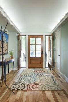 Entry way with contemporary rug and Crate and Barrel coat stand - love it
