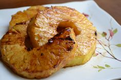 A sweet simple delicious side of grilled pineapple, with a light coating of sugar and cinnamon.  Possibly, a little slice of heaven.