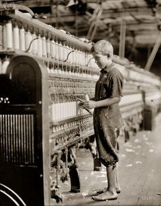 """September 1910. North Pownal, Vermont. """"Clarence Wool, 11 years. Spinner in North Pownal Cotton Mill. Worked only during vacation."""" Photograph (original glass negative) and caption by Lewis Wickes Hine. View full size."""