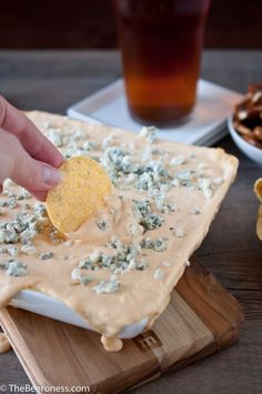 Buffalo Chicken Beer Cheese Dip- 8 oz sour cream, 16 oz cream cheese (softened), 1 ½ cups shredded parm. cheese, 1/3 cup Franks Red Hot Sauce,   2/3 cup IPA beer, 1 tsp garlic powder, 2 tbs cornstarch, ½ cup mozzarella, shredded, ½ cup blue cheese crumbles