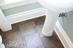 DIY decorative baseboard trim:  1st Floor Powder room