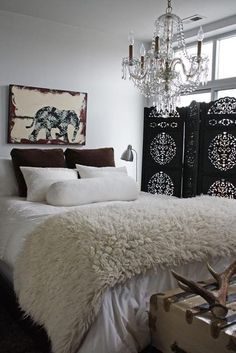 So cozy. love the white comforter with the cream throw and the diy elephant photo in the plum accents to match pillow.  Beautiful