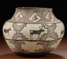 Southwest Painted Pottery Olla, Zuni, c. late 19th century, with high shoulder and slightly flared rim, decorated with three bands of stylized geometric designs, the rim band with diamond shapes framing red-brown birds, the middle band with heartline deer