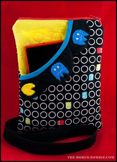 Pac-Man Purse.  What a great idea for a purse.  Remember pacman, played all the time when was younger.  Peace, Robert from nancysfabrics.com
