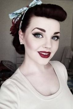 http://www.mahogany.com.br/blog/como-fazer-estilo-pin-up/   CAN I JUST HAVE THIS? Hair color, bow, make up, etccccc.
