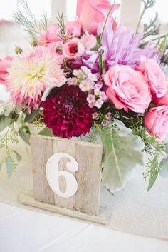 Table numbers/centerpieces    Photography by rebeccaarthurs.com, Floral Design by flowerthyme.com