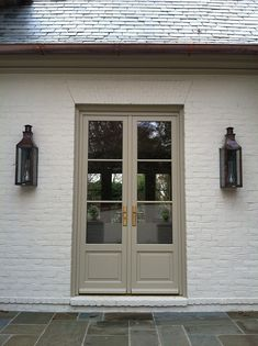 love the detailing on the doors, painted brick and fixtures
