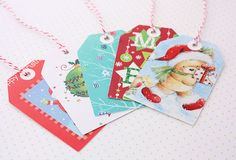 Recycled Christmas Cards! This is one of my favorite after-Christmas traditions - challenging myself to make the most of every beautiful card, by punching them out to re-use as tags next year.