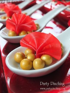 chinese new year dessert spoons, chinese new year fans, fruit roll up fans and gold sixlet candies