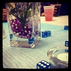 My husband and I both work at a casino as crap dealers  ...how appropriate to have dice on the tables