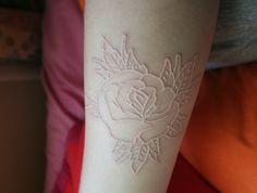 White ink.  Unique! white roses, white tattoos, dragon tattoos, rose tattoos, tattoo patterns, flower tattoos, white ink tattoos, tattoo ink, whiteink