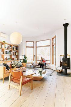 Living room wood floors wood stove mjolk-house-living-room