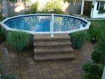semi inground pool with stone steps