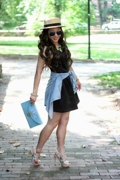 Make an LBD casual for a stroll with a chambray shirt tied around the waist.