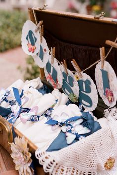 Fill a vintage suitcase with blankets and pashminas for your guests comfort in case of chilly weather. Source: Beaux Arts Photography #reception #favors idea, 10 creativ, guest