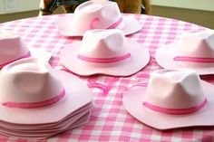 cowgirl party activity - decorate hats; this was so much fun at EG's 4th birthday!  Cute little foam stickers can be found in just about any theme at Hobby Lobby :)
