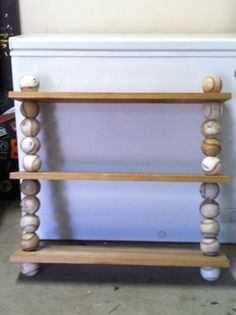 Wonder if I could do this with Grady's old soccer balls that won't hold air cut and put around something more solid for stability then build shelf?