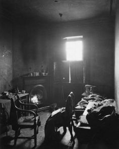 Interior of miner's tenement  Photograph: E. Smith (1954).    A similar space to Bacons studio but this time a home - again a real place.