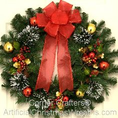 Thin Christmas Wreath - 2014 - Our latest design - Our Thin Christmas Wreath is a tasteful blending of pine cones, snow tipped firs, red berries, Christmas balls and a beautiful red bow. This wreath is only (app.) 3'' in depth which should be thin enough to fit between storm doors! #ChristmasWreath #ThinWreath #StormDoorWreath