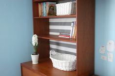 lining a bookcase with wrapping paper