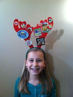 Reindeer antler headbands 2 for $1 at Dollar Tree and stapled the badges on.