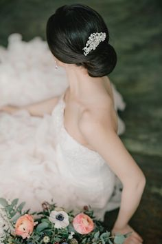 Chic low bun hairstyle | Irina Klimova Photography | see more on: http://burnettsboards.com/2014/09/beauty-flower-exquisite-bridal-editorial/