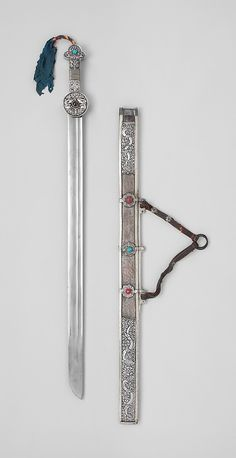 Sword and Scabbard Date:     18th–19th century Culture:  Tibetan Medium:  Iron, silver, wood, textile, turquoise, coral, leather