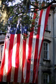 Giant flag draped along these Savannah homes! (Source: christopherhornadayphotography)