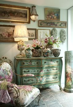 French Dresser, old oils of roses, iron chair with flowered cushion - fresh flowers, love the floor, and so on!