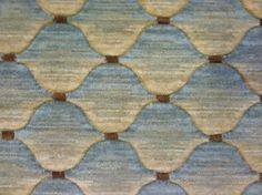 This is a 100% woven wool carpet remnant with a fish scale pattern. http://www.carpetworkroom.com