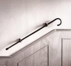 Is it a decorative handrail or a practical way to keep your cane handy?
