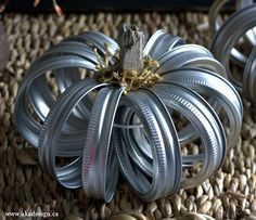 Pretty crafty - a pumpkin made of mason jar lids! Quick and easy (and cheap)!