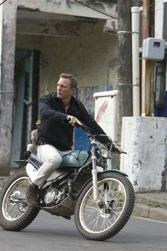 Daniel Craig as James Bond in Quantum of Solace cruising on a Scrambler Motorcycle through the streets of Bolivia.