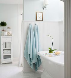 Just the softest touch of blue on walls paired with clean white everything else.