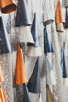 metallic backdrop // photo by Mr. Haack // party backdrops, holiday parties, paper cone, metal backdrop, party hats, new years eve, parti idea, photo backdrops, photo booth