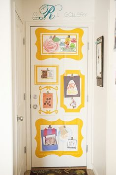 Fabulous kid's art display with vinyl to brighten up door!!