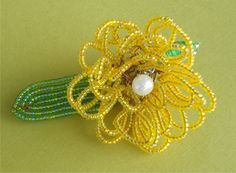 http://www.afday.com/collections/jewellery-1/products/yellow-beaded-broach  Rs 125