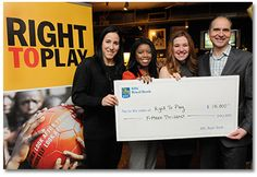 RBC Olympians Caroline Ouellette, Perdita Felicien and Clara Hughes present Right To Play National Director Robert Witchel with a $ 15,000 donation as part of the RBC Olympian Grant Program