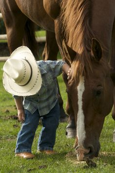 A little cowboy and his horse