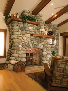 Handmade Fieldstone fireplace with intricate custom copper fire screen.