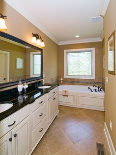 Master bathroom from the Runnymeade Plan 1164 http://www.dongardner.com/plan_details.aspx?pid=3402 - Compact yet charming, this home includes all the details of a much larger home. #House #Designs #MasterBathroom #Small