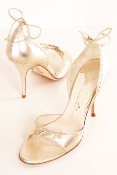 Alexandra Neel gold leather heels. The bows at each heel and toe give these shoes a feminine touch.