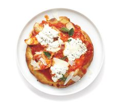 Chicken and Ricotta Pizza recipe: Skip the heavy mozzarella and use ricotta and Parmesan for a lighter, fresher pie.